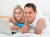 Happy Couple Shopping Online — Stock Photo