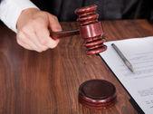 Male Judge Striking The Gavel — Stock Photo