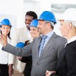 Stock Photo: Architects Working On Blueprint