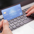 Man Sitting With Laptop And Credit Card Shopping Online — Stock Photo