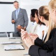 Businesspeople Clapping For A Man In Meeting — Stock Photo #29295369