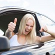 Happy Woman In A Car Showing A Key — Stock Photo