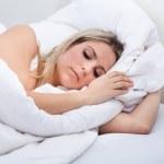 Upset woman lying on bed — Stock Photo #29296151