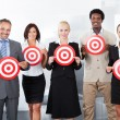 Businesspeople Holding Dartboard — Stock Photo #29296169