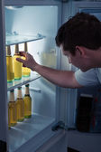 Man taking beer from a fridge — Stock Photo