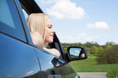 Young Blonde Woman Leaning On Car Window — Stock Photo