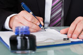 Businessman Writing With Ink Pen — Stock Photo