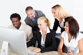 Group Of Businesspeople Looking At Computer — Stock Photo