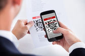 Businessman Scanning A Barcode — Stock Photo