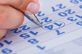 Close-up Of Man Marking On Calendar — Stock Photo