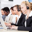 Beautiful Young Woman Talking On Headset — Stock Photo #29747561