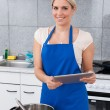 Woman Using Digital Tablet In Kitchen — Stock Photo