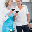 Happy Mature Drinking Wine In Kitchen — Stock Photo #29747929