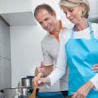 Happy Mature Couple Cooking Food In Kitchen — Stock Photo