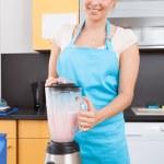 Woman Making Strawberry Milkshake — Stock Photo
