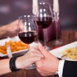 Couple Holding Hand At Restaurant — Stock Photo