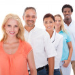 Foto Stock: Group Of Multi-ethnic People Standing In A Row