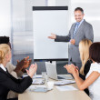 Stock Photo: Businesspeople Clapping For MIn Meeting