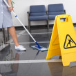 Foto Stock: Maid Cleaning Floor