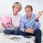 Shocked Couple Holding Piggybank — Stock Photo