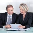Mature Businessman And Businesswoman At Work — Stock Photo
