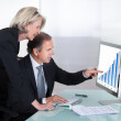 Mature Businessman And Businesswoman Looking At Graph — Stock Photo