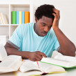Worried Young African Man Studying — Stock Photo