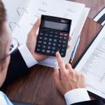 Businessman Using Calculator — Stock Photo