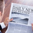 Close-up Of Businessman Reading Weather News — Stock Photo