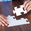 Close-up Of Businessman Completing Jigsaw Puzzle — Stock Photo