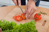 Man Cutting Vegetables — Stock Photo