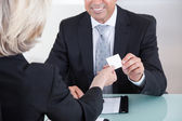 Businesspeople Exchanging Visiting Card In Office — Stock Photo