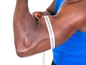 African Man Measuring His Biceps — Stock Photo