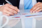 Businessman Writing On Graph — Stock Photo
