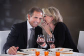 Cheerful Woman Whispering In Man's Ear — Stock Photo