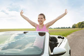Woman Raising Hand In Car — Stock Photo