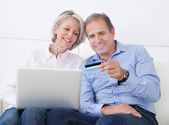 Happy Mature Couple Shopping On Laptop — Stock Photo