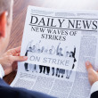 Close-up Of Businessman Reading News On Newspaper — Stock Photo