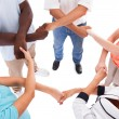 Multi-racial Hands Holding Each Other — Stock Photo #30372821