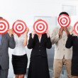 Businesspeople Holding Dartboard — Stock Photo