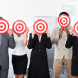 Stock Photo: Businesspeople Holding Dartboard