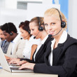 Stock Photo: Beautiful Young Woman Talking On Headset