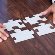 Stock Photo: BusinessmHolding Jigsaw Puzzle