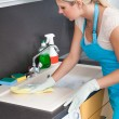 Stock Photo: WomCleaning Worktop