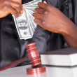 Male Judge Putting Dollar In His Pocket — Stock Photo
