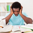 Worried Young African Man Studying — Stock Photo #30373777