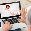 Stock Photo: Mvideo chatting with woman