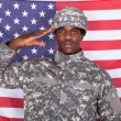 Army Soldier Saluting In Front Of American Flag — Stock Photo