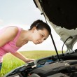Woman Looking Under Hood Car — Stock Photo #30374007