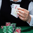 Stock Photo: Croupier holding playing cards